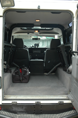 interior rear portion of the defender with the jump seats folded up