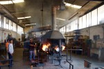 Glass artists at Xaquixe Glass works struggle to get their furnace burning smoothly.